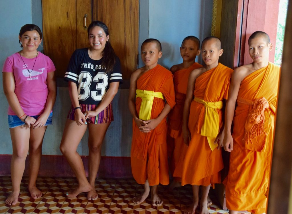 American girls with Cambodian boy monks near Siem Reap, Cambodia