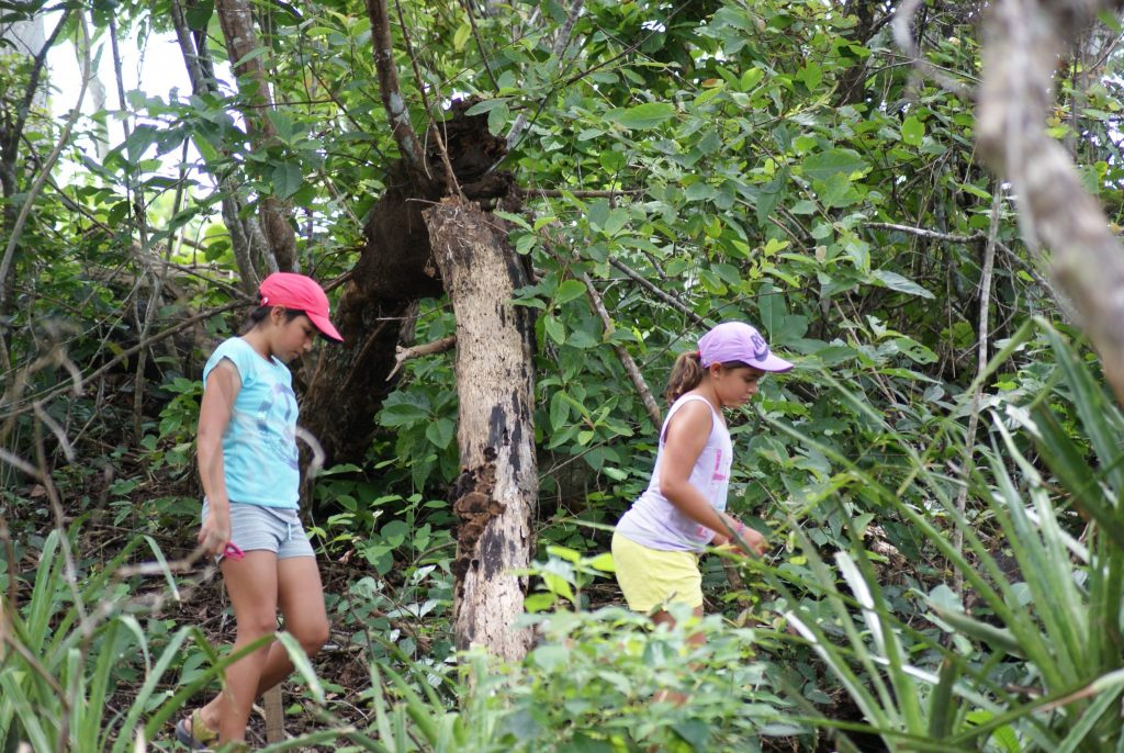 girls hiking in jungle of Costa Rica natural park