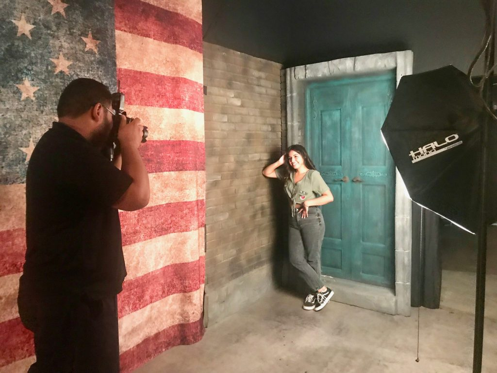teen girl poses for photo shoot in studio