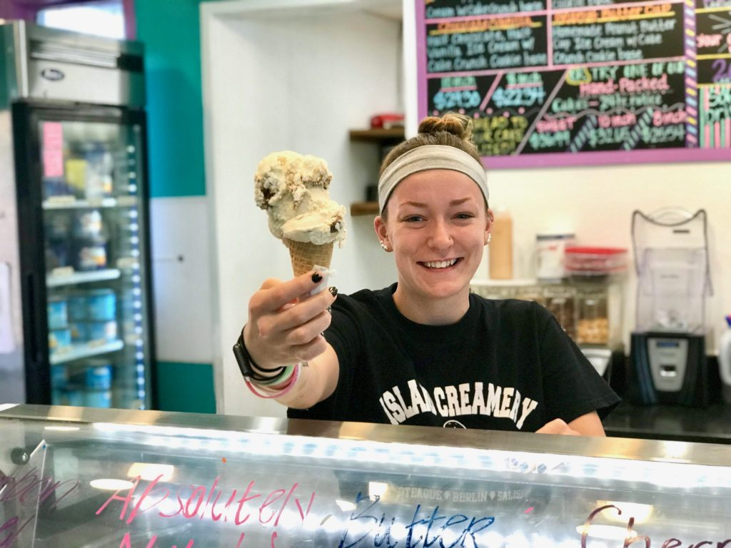 Girl serves giant ice cream cone at Island Creamery in Wicomico County, Maryland