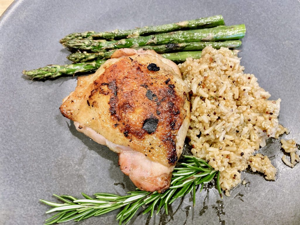 grilled lemon rosemary chicken recipe on plate with grilled asparagus and rice pilaf