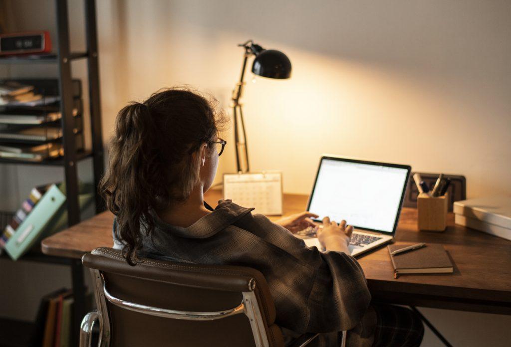 Teen girl doing homework on her laptop