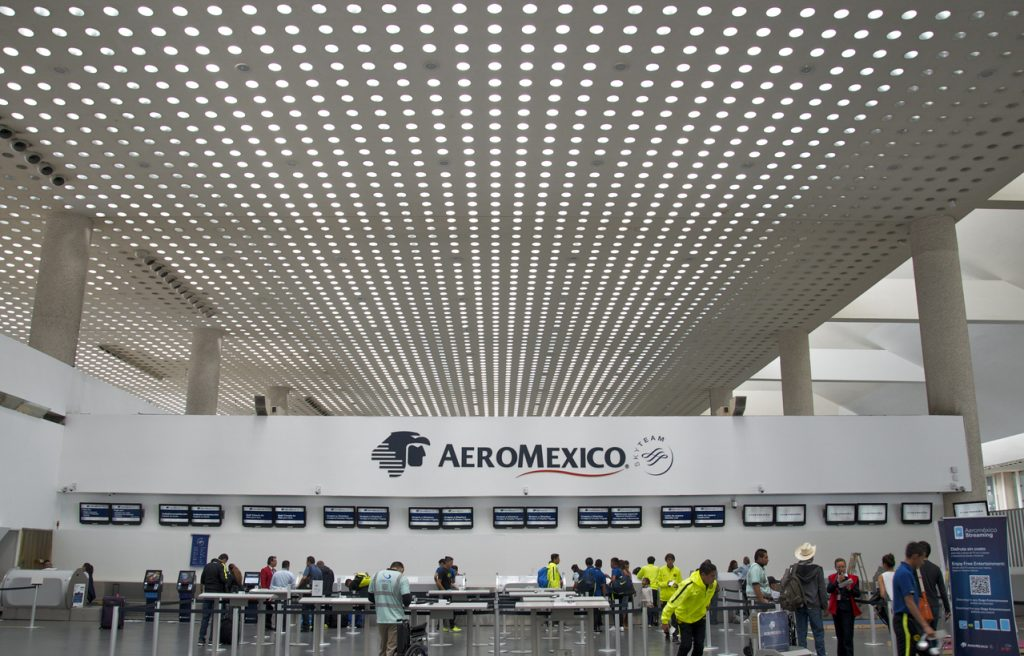 Aeromexico check in counter at Benito Juarez International Airport in Mexico City. This airport is the busiest in Latin America, and it has interesting architecture details.
